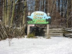entrance sign for Otter River Farms